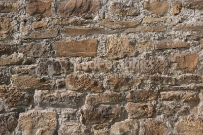 Irregular natural old stone wall texture