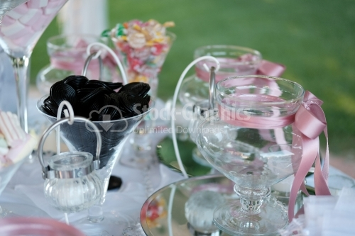 Italian candy bar with licorice snails and many glasses with pink ribbons