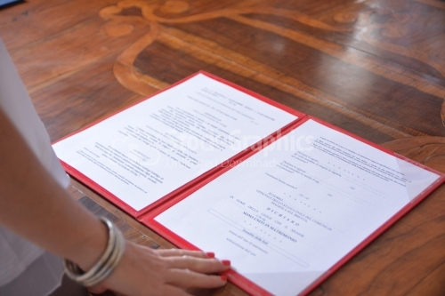 Italian marriage certificate on wooden table