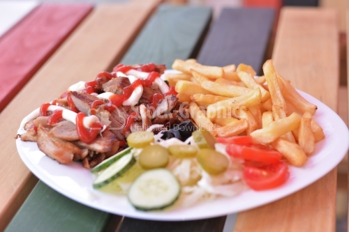 Kebab sandwich on white plate.