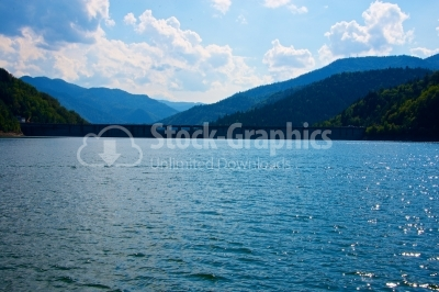 Lake and mountain in reservoir with evening sky and blue sky clo