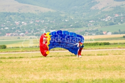 Landing of the skydiver on the ground