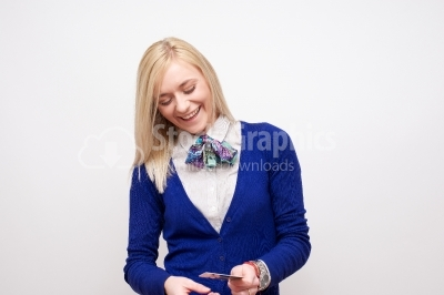 Laughing young woman with a credit card