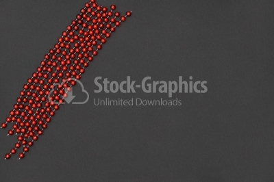 Mardi Gras beads against dark background