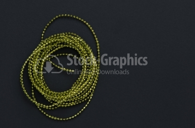 Mardi Gras beads isolated on dark