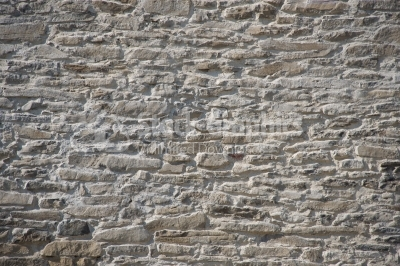 Monochromatic background old stone wall narrow