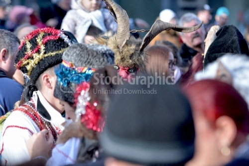 Monster / Devil mask focused on the crowd.The annual Winter Traditions and Customs Festival.