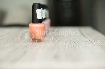 Nail polis on wooden surface