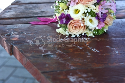 Nice bouquet of flowers placed on a old wood table