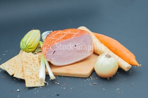Nice wooden cutboard with smoked ham and vegetables