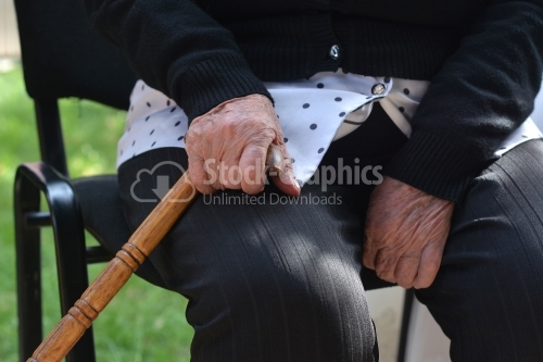 Old man holding a walking stick