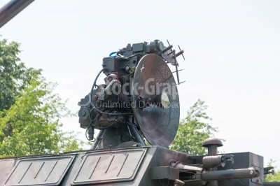 Old radar over a tank
