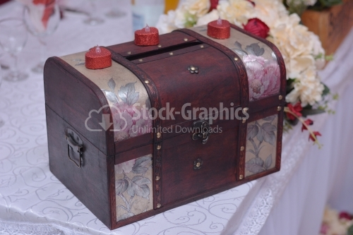 Old wedding coffer for money with red candles