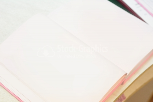 Open notebook with white background on the table