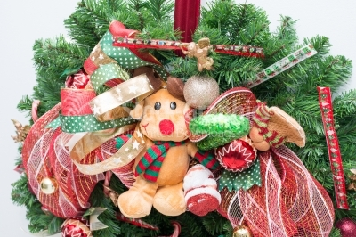 Ornamental wreath with reindeer and green candy