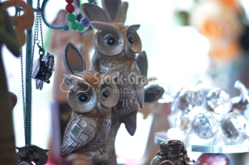 Owls statue, trinket as a decoration object on flat background.