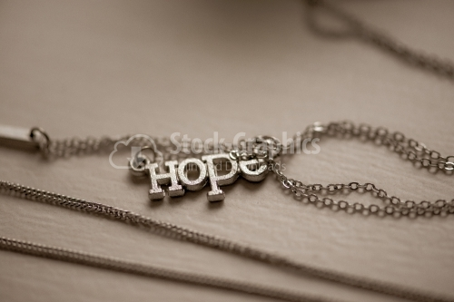 Pendant with word Hope closeup