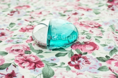 Perfume bottle on a table with a floral background