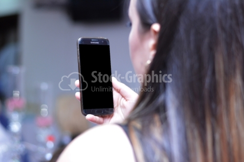 Phone in the hand of a young girl
