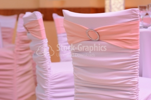 Pink bow between silver cutlery