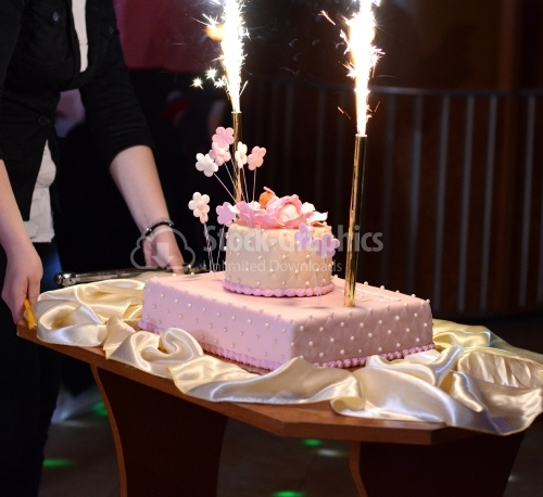 Pink cake with fireworks