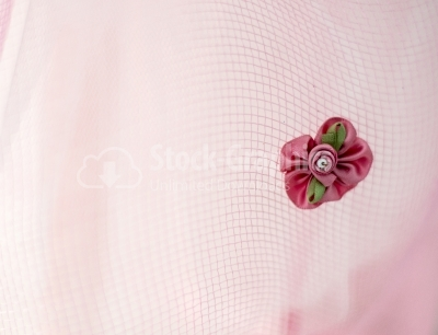 Pink flower on pink fabric