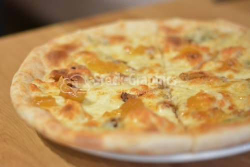 Pizza with four kinds of cheese. Italian pizza. Pizza quattro formaggi.