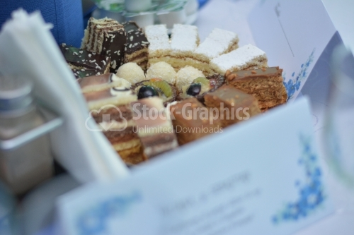 Plateau with fruits tarts, cocoa cakes and vanilla cakes
