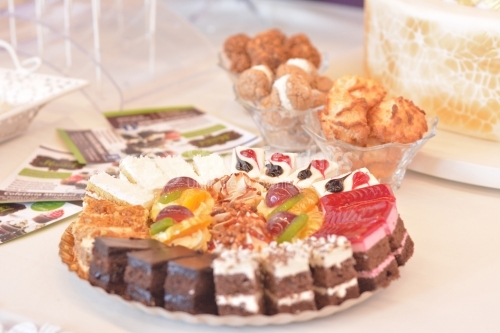 Platter with various cakes with cream in layers