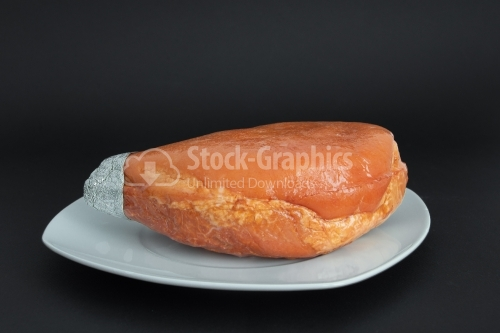 Prague ham on a white plate