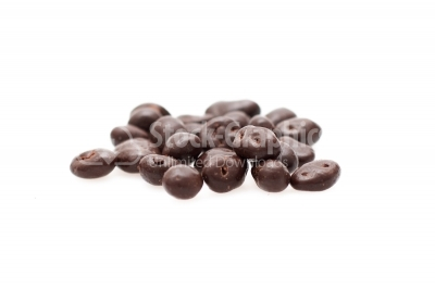 Raisin with chocolate on whtie background