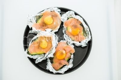 Raw eggs on pieces of salmon