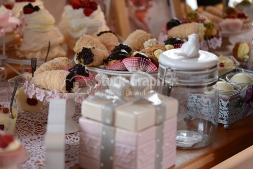 Rolls with crunchy chocolate and decorative jars around. Candy bar