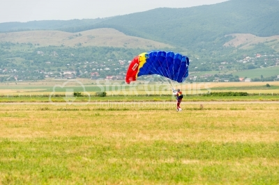 Romanian skydiver on the meadow