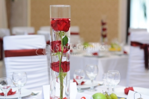 Rose placed in a vase with water on a wedding table