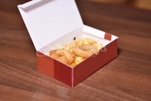 Rounds of onion and fries in a red cardboard box on the wooden table