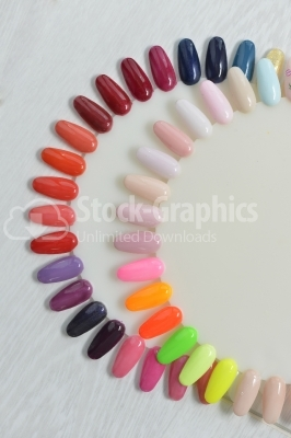 Samples of nail varnishes on a white parquet
