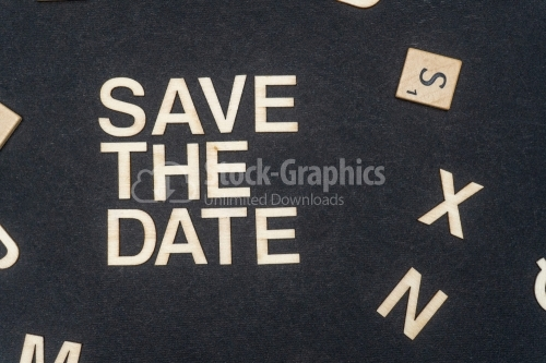 SAVE THE DATE word written on dark paper background. SAVE THE DATE text for your concepts