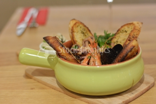 Seafood and toast with aromatic oils.