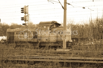 Sepia Locomotive in station. Train of the National Railway Compa