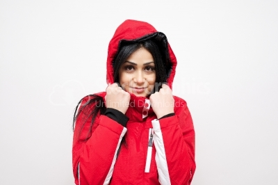 Smiling young woman in a red winter coat