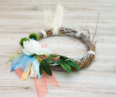 Spring wreath on wood table