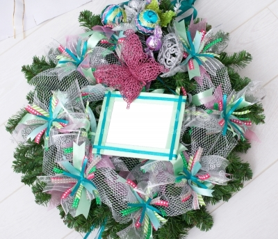 Spring wreath with ribbons and silver decoration isolated on white