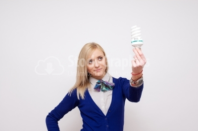 Stock image of girl holding an energy saving compact flourescent