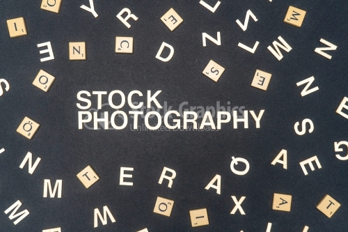 STOCK PHOTOGRAPHY word written on dark paper background. STOCK PHOTOGRAPHY text for your concepts