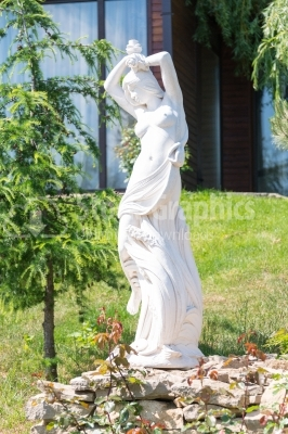 Sun-lighted statue of a woman