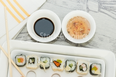 Sushi plate with sauces top view