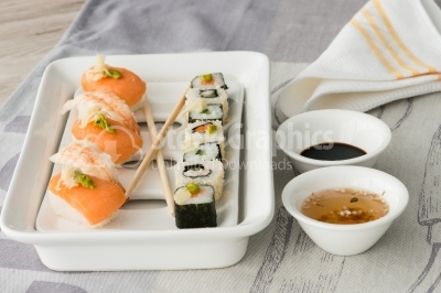Sushi with soy sauce and sweet and sour sauce