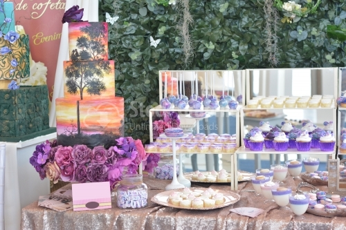 Sweet dessert table or candy bar. Wedding party. Natural light. Macaron and cupcakes .Anniversary dating one celebration.