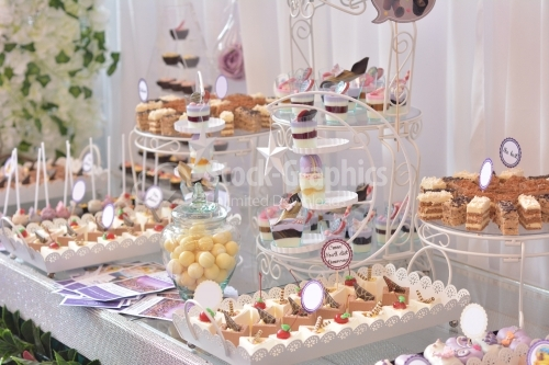 Table full with cakes and sweets at a wedding reception